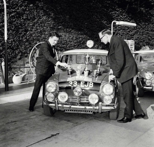 Paddy counts the silverware while his co driver Henry Liddon looks on.