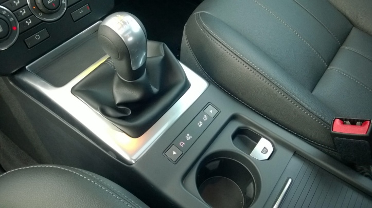 The 6 speed gearbox has a pleasant change action. Push button terrain selection is simplicity itself but the gear lever gaitor feels thin and cheap to the touch.