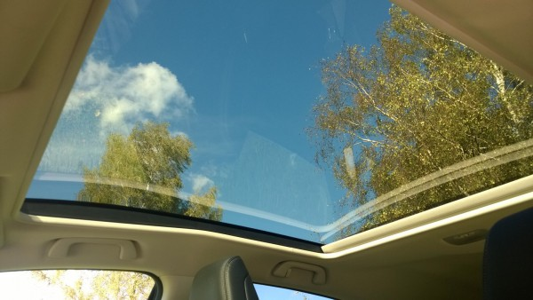 Standard panoramic roof brings welcome extra light into a slightly dark and sombre interior without stealing headroom. The blind is power operated