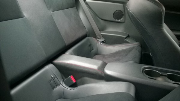 Rear seats provide little more than some extra space for luggage or shopping - Its very tight for space here!