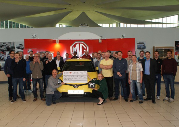 MG design and engineering staff pose alongside their well deserved cheque for Macmillan Cancer Support.