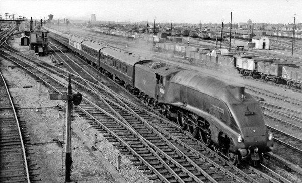 Eastern Glory Days - A Gresley designed A4 Pacific coasts past Peterborough North signal box with an up-fast Kings Cross bound service.