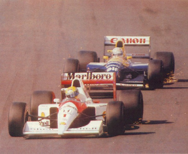 With Senna, sparks flew on and off the race track. This image portrays the glory days of F1 as Senna and Mansell dogfight for supremacy.