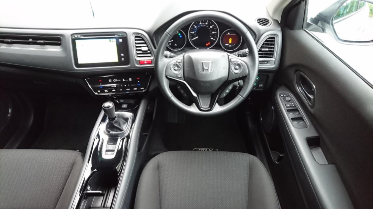 Snug and comfy driving position is let down by fiddly touch sensitive climate panel and spindly gear knob.