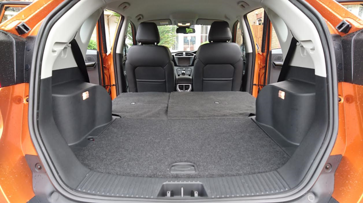 Whopping boot and seats that fold and lock down flat to the floor. There's also a charging point on the floor but the sliding loadbay cover feels flimsy in use.